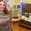 (Brad Davis/The Register-Herald) You'd get a cool booklet with a sticker and a fewsample works if you went by artist Brian Zickafoose during Small Business Saturday yesterday in Uptown Beckley.