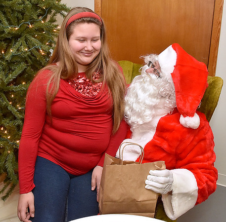 """(Brad Davis/The Register-Herald) If you ask 11-year-old Amelia Shrader, she'll tell you it's never too early to talk to Santa about next year, but Santa wanted to know if she got everything she wanted this Christmas, to whic she replied, """"yes,"""" during Sophia United Methodist Church's Community Christmas Dinner Sunday afternoon."""