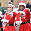 (Brad Davis/The Register-Herald) Majorettes from Park Middle School twirl batons as they march during Beckley's Christmas Parade Saturday afternoon.