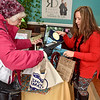 (Brad Davis/The Register-Herald) Beckley resident Meg Homan picks up a $10 painting from artist Melanie Hicks during the first ever Small Business Saturday shopping event yesterday in Uptown Beckley.