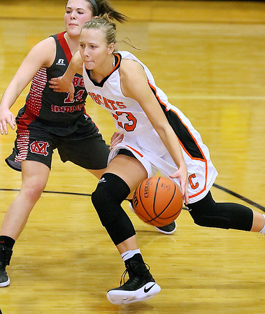 (Brad Davis/The Register-Herald) Summers County's Brittney Justice cuts around Cabell Midland's Sierra Womack during the Rogers Oil Classic championship game Saturday night in Hinton.