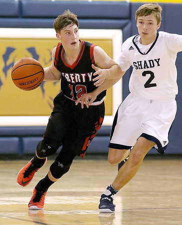 (Brad Davis/The Register-Herald) Liberty's Nate Griffith drives up the court as Tigers defender Tommy Williams stays on him Friday night in Shady Spring.
