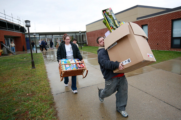 People carry toys out during the Mac's Toy Fund at the Beckley-Raleigh County Convention Center on Saturday. (Chris Jackson/The Register-Herald)