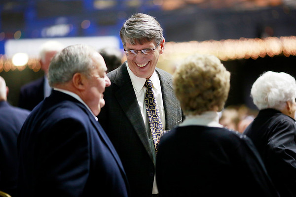 Donnie Holcomb, center, shares a laugh with Andy and Pat Earehart during the Spirit of Beckley Awards Monday at the Beckley-Raleigh County Convention Center. (Chris Jackson/The Register-Herald)