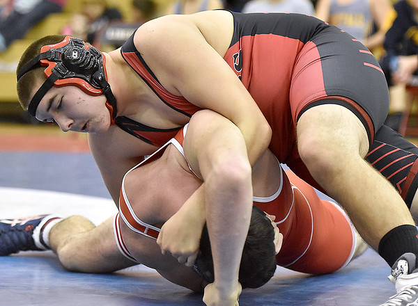 (Brad Davis/The Register-Herald) Liberty's Devin Vance takes on Man's Matt Raney in a 195-pound weight class matchup Saturday afternoon at the Raider Rumble in Glen Daniel. Man's Raney won the match.