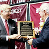 Master of Ceremonies Bill O'Brien hands Dave Barksdale the Spirit of Beckley Award during the annual YMCA of Souther West Virginia event Monday at the Beckley-Raleigh County Convention Center. (Chris Jackson/The Register-Herald)