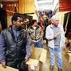 Volunteer Ron Buchanan, right, helps Nathaniel Mayo, left, and Chris Shrewsberry get boxes during the Mac's Toy Fund at the Beckley-Raleigh County Convention Center on Saturday. (Chris Jackson/The Register-Herald)