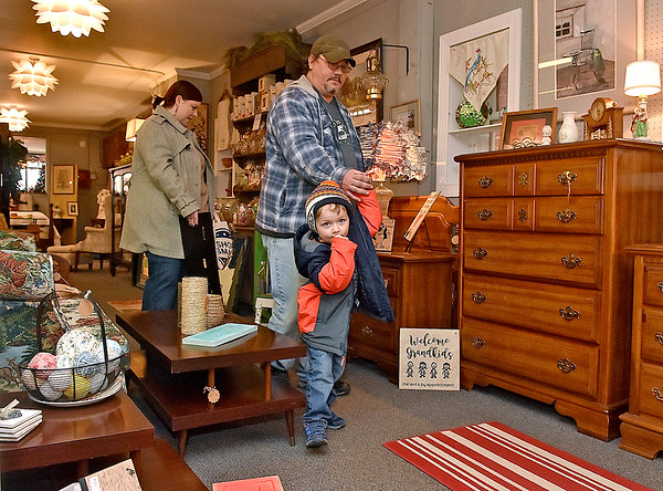 (Brad Davis/The Register-Herald) Three-year-old Mason Ellison leads the way as he and parents Jason and Melanie shop inside Tickety Boo during Small Business Saturday yesterday in Uptown Beckley.