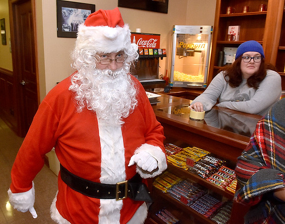 (Brad Davis/The Register-Herald) Santa Claus makes a pass through The Raleigh Playhouse & Theatre as he arrives at Small Business Saturday yesterday in Uptown Beckley.