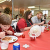 (Brad Davis/The Register-Herald) The Shrader family, consisting of members (from left) Cohen, 9, Pam, Mark and 11-year-old Amelia, chow down on a hot meal during Sophia United Methodist Church's Community Christmas Dinner Sunday afternoon.