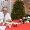 (Brad Davis/The Register-Herald) A slightly camera-shy Gary Parker and his wife Cindy have a few laughs during Sophia United Methodist Church's Community Christmas Dinner Sunday afternoon.
