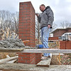 (Brad Davis/The Register-Herald) Bricklayer Steve Radford, owner of Mountaineer Masonry in Stanaford, works to rebuild the big brick sign outside of the Beckley Medical Arts building off Kanawha Street Thursday afternoon, which had been reduced to a debris pile after being destroyed a handful of months ago by an automobile accident. Radford's work can literally be see all over town, as he's had a hand in building schools, residences and business establishments throughout the Beckley area.