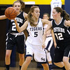 (Brad Davis/The Register-Herald) Shady Spring's Bri Reed looks for an open teammate along the perimeter as Westside defenders Carla Cook, left, and Makayla Morgan converge on her Thursday night in Shady Spring.