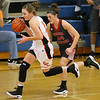 (Brad Davis/The Register-Herald) Summers County's Hannah Taylor races past Cabell Midland's Sierra Womack after scooping up a loose ball during the Rogers Oil Classic championship game Saturday night in Hinton.