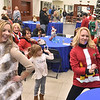 (Brad Davis/The Register-Herald) Attendees dance the night away at the Mountaineer Automotive silent auction and Christmas fundraising party for Mac's Toy Fund Thursday night inside the showroom of the Eisenhower Drive dealership.