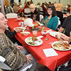 (Brad Davis/The Register-Herald) Community members Gary Shultz, lower left, Mera Vincent (hidden at left behind Shultz), Dinah Blevins (back turned at lower right), Mary Ann Milano (right side of table left to right), Amabile Milano and Charles Wyatt enjoy a Christmas dinner at Sophia United Methodist Church Sunday afternoon.