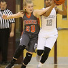 (Brad Davis/The Register-Herald) Summers County's Tiffani Cline rushes in to knock the ball loose from Woodrow Wilson's Lyric Moon Wednesday night in the Woodrow gym.
