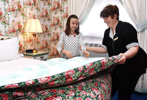 Candance White, room attendent, right, shows Delia Teaney, 11, student from Lewisburg Elementary School, special techniques on how to make a bed, during Apprentice Day held at The Greenbrier Resort.<br /> (Rick Barbero/The Register-Herald)