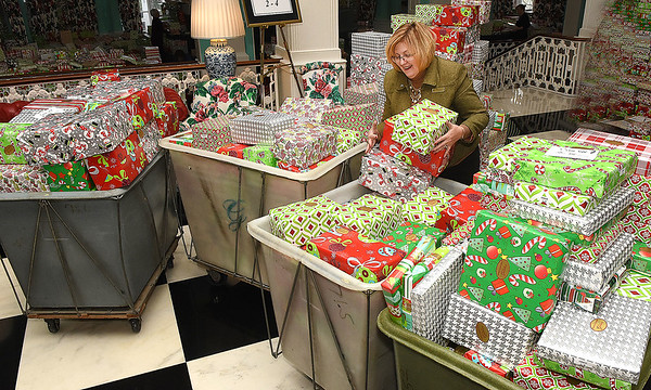 Robin Mieras, employee for The Greenbrier Resort, helps organize Christmas gifts for the Dream Tree Children distribution.<br /> (Rick Barbero/The Register-Herald)