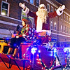 (Brad Davis/The Register-Herald) Santa Claus greets the crowd with enthusiasm as he rolls up Main Street during Oak Hill's Christmas Parade Thursday night.