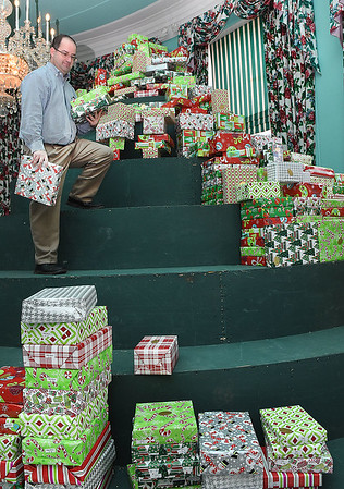 Anthony Warthan, employee for The Greenbrier Resort, carries down Christmas gifts for the Dream Tree Children distribution.<br /> (Rick Barbero/The Register-Herald)