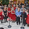 (Brad Davis/The Register-Herald) Young singers from The New River Youth Symphony & Chorus' Beginner Chorus perform a few songs for holiday shoppers at the Crossroads Mall Saturday afternoon.