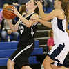 (Brad Davis/The Register-Herald) Westside's Makayla Morgan drives to the basket as Shady Spring's Bri Reed defends Thursday night in Shady Spring.