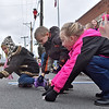 (Brad Davis/The Register-Herald) Young spectators rush for the candy as it's thrown from passing floats during Fayetteville's Christmas Parade Saturday evening