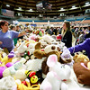 People look over stuffed animals during the Mac's Toy Fund at the Beckley-Raleigh County Convention Center on Saturday. (Chris Jackson/The Register-Herald)