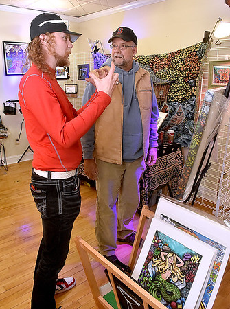 (Brad Davis/The Register-Herald) Artist Brian Zickafoose talks to shoppers during Small Business Saturday yesterday in Uptown Beckley.