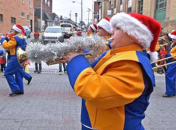 (Brad Davis/The Register-Herald) The Shady Spring Middle School Marching Band is in the spirit as they perform during Beckley's Christmas Parade Saturday afternoon.