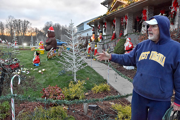 (Brad Davis/The Register-Herald) Area resident Walt Kiser shows off the progress he's made in turning his front yard into a Christmas wonderland at his Grandview Road home Friday afternoon. Kiser, a retired coal miner formerly from Oceana, has a history of decking out his yard for Christmas and has accumulated tons of excess decorations that he's currently letting go in a garage sale. He's been working on this one since November 6th and says this will probably be one of the last big setups he'll do. Just travel Grandview Road towards Shady Spring and you can't miss his Christmas wonderland.