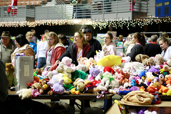 People look over items during the Mac's Toy Fund at the Beckley-Raleigh County Convention Center on Saturday. (Chris Jackson/The Register-Herald)