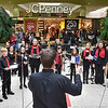 (Brad Davis/The Register-Herald) Members of The New River Youth Chorus perform a few songs for holiday shoppers at the Crossroads Mall Saturday afternoon.