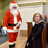 (Brad Davis/The Register-Herald) A youngster meets Santa during Small Business Saturday yesterday in Uptown Beckley.
