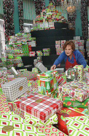 Betsy Conte, employee for The Greenbrier Resort, helps distribute Christmas gifts for the Dream Tree Children distribution held at The Greenbrier Resort.<br /> (Rick Barbero/The Register-Herald)