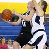 (Brad Davis/The Register-Herald) Westside's Makayla Morgan drives to the basket as Shady Spring's Ashley Harding defends Thursday night in Shady Spring.