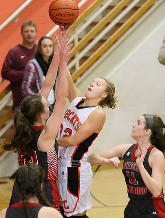 (Brad Davis/The Register-Herald) Summers County's Whittney Justice drives to the basket as Cabell Midland's Haley Waugh, left, and Morgan Bennett defend during the Rogers Oil Classic championship game Saturday night in Hinton.