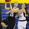 (Brad Davis/The Register-Herald) Westside's Brooke Gallion drives to the basket as Shady Spring's Sydney Cross defends Thursday night in Shady Spring.