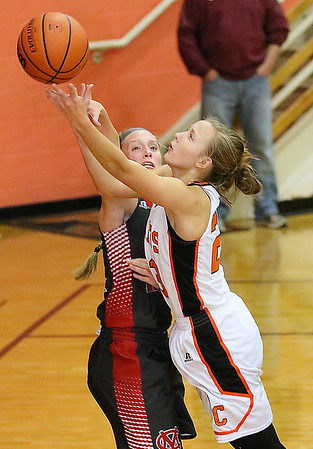 (Brad Davis/The Register-Herald) Summers County's Brittney Justice drives to the basket as Cabell Midland's Faith Craddock defends during the Rogers Oil Classic championship game Saturday night in Hinton.