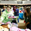 Delaney Wykle, right, from Beckley, helps Juanita Vance, from Beckley, with toys during the Mac's Toy Fund at the Beckley-Raleigh County Convention Center on Saturday. (Chris Jackson/The Register-Herald)
