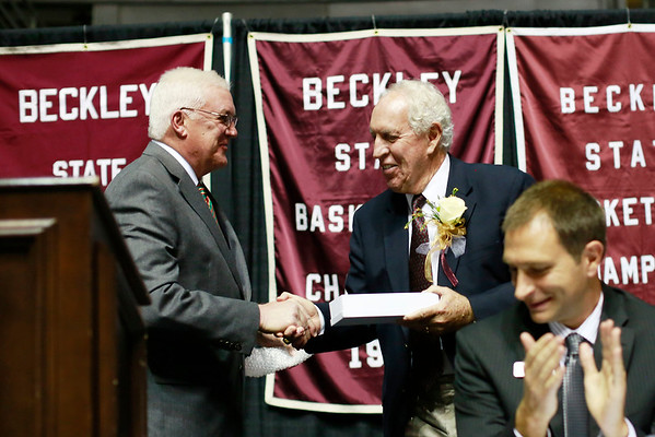 Beckley Mayor Rob Rappold hands Dave Barksdale the key to the city during the Spirit of Beckley Awards Monday at the Beckley-Raleigh County Convention Center. (Chris Jackson/The Register-Herald)