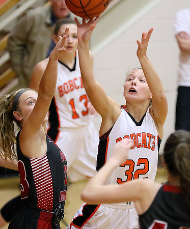 (Brad Davis/The Register-Herald) Summers County's Whittney Justice drives to the basket as Cabell Midland's Kirya Kingery defends during the Rogers Oil Classic championship game Saturday night in Hinton.