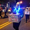 (Brad Davis/The Register-Herald) Participants make their way up Main Street during Oak Hill's Christmas Parade Thursday night.