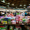 People look over toys during the Mac's Toy Fund at the Beckley-Raleigh County Convention Center on Saturday. (Chris Jackson/The Register-Herald)