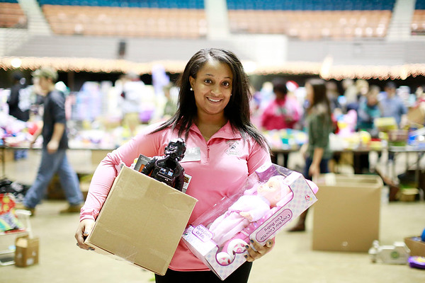 Japri Miller, from Beckley, has volunteered at Mac's Toy Fund for 10-years. Pictured here during the Mac's Toy Fund at the Beckley-Raleigh County Convention Center on Saturday. (Chris Jackson/The Register-Herald)