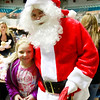 Lauren Mahaffey, 7, with Santa Claus during the Mac's Toy Fund at the Beckley-Raleigh County Convention Center on Saturday. (Chris Jackson/The Register-Herald)