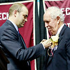 Ty Barksdale, Dave Barksdale son, pins his father during the Spirit of Beckley Awards Monday at the Beckley-Raleigh County Convention Center. (Chris Jackson/The Register-Herald)