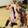 (Brad Davis/The Register-Herald) Summers County's Hannah Taylor drives to the basket through Cabell Midland defenders Sierra Womack (background) and Emily Charles during the Rogers Oil Classic championship game Saturday night in Hinton.