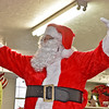(Brad Davis/The Register-Herald) Santa Claus, probably sled-lagged and exhausted from another annual 24-hour delivery run, still found time to drop in for Sophia United Methodist Church's Community Christmas Dinner Sunday afternoon.